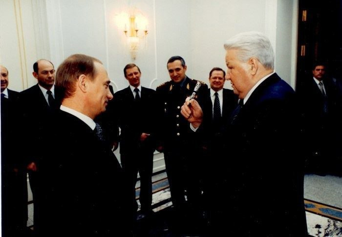 Yeltsin gives to Putin the handle which signed his decree on resignation, 1999.