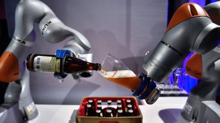 The robot of Kuku company shows the accuracy of movements, pouring beer in a glass