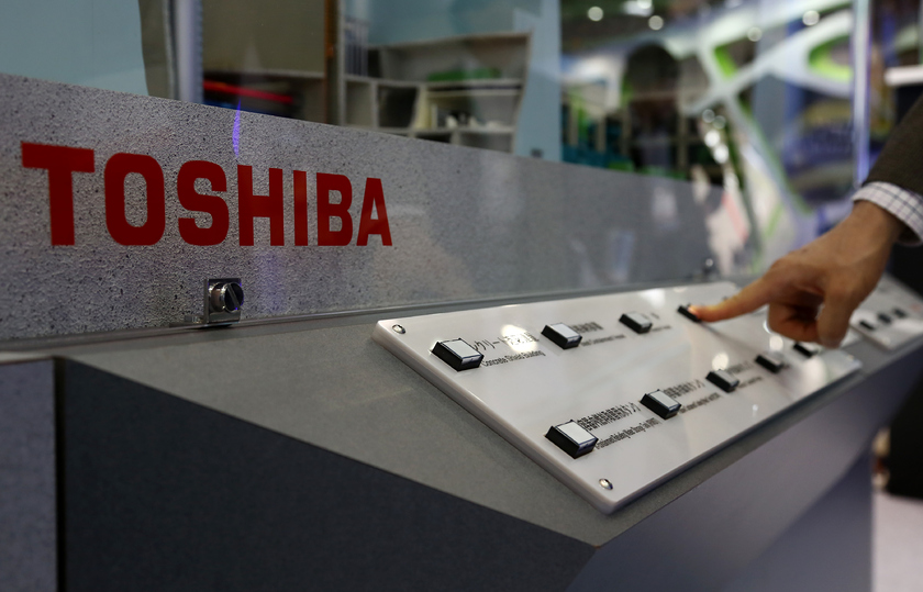 The employee of Toshiba clicks in a management system for the nuclear reactor